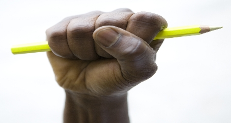 hand fisted and holding pencil
