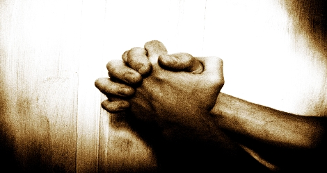 photo of hands clasped in prayer