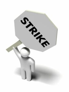 cartoon of person holding strike sign