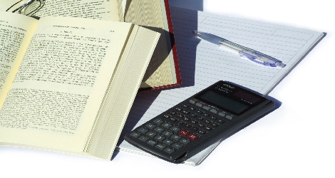 photo of books, paper and calculator