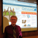 photo of patrick heery with projection of Unbound at launch