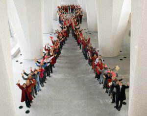 people lined up in shape of AIDS ribbon