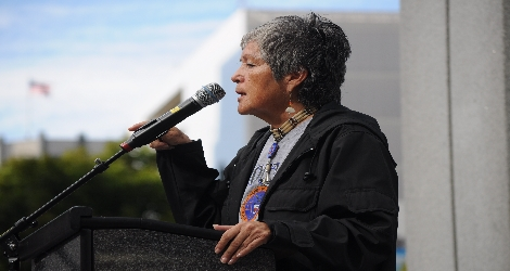 photo of indigenous woman speaking at rally