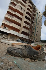 photo of abandoned shoe in front of building