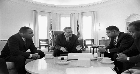 photo of civil rights leaders, including Dr. King, meeting with Lyndon Johnson