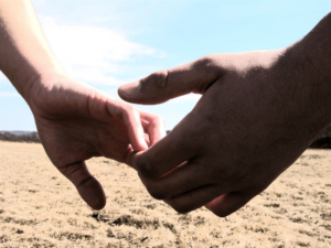 photo of hands touching