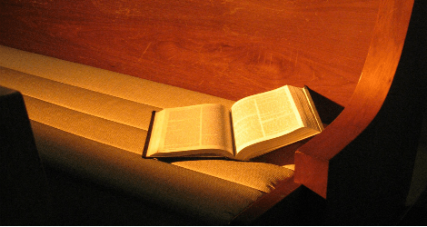 Bible in pew by Amy Burton