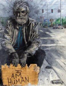 "homeless man holding sign ""i am human"""