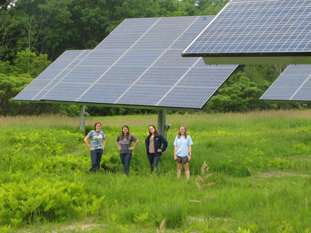 eco-stewards with solar panels