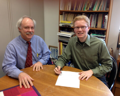 Rev. Dr. Chris Iosso (left) and Rev. Patrick Heery signing BSA letter