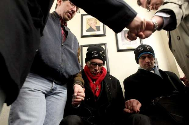 """Rev. Maurice """"Bojangles"""" Blanchard and his partner, Dominique James, joined by supporters as they pray and nonviolently protest marriage inequality"""