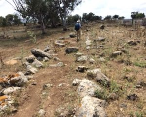 This is what remains of an ancient Roman road. You can see more ancients stones poking through the soil.