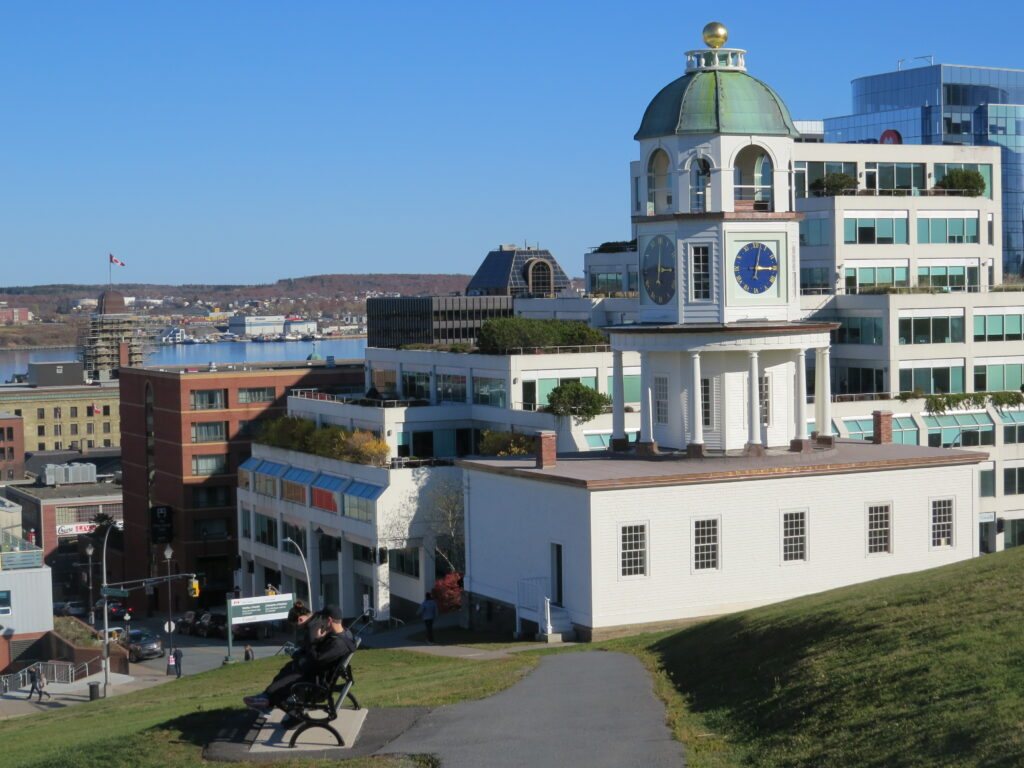 An image of a walking path on citadel hill in halifax with the clock tower and harbour visible