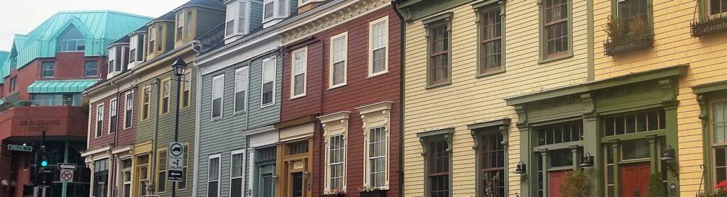 A row of colourful houses along a Halifax street