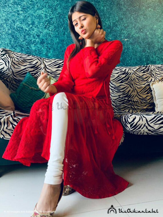 Ameliorate your Style Quotient (SQ) with this meticulously designed Red Georgette Angrakha style Anarkali Kurta with fine Aari work with staple thread all over at the front side and at the back side of the kurta