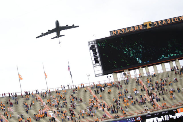 A military craft flies over the stadium leading up to kickoff of a football game between Alabama and Tennessee at Neyland Stadium in Knoxville, Tenn. on Saturday, Oct. 24, 2020.