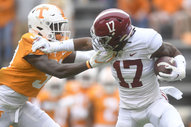 Alabama wide receiver Jaylen Waddle (17) pushes away Tennessee defensive back Kenney Solomon (31) during a game between Alabama and Tennessee at Neyland Stadium in Knoxville, Tenn. on Saturday, Oct. 24, 2020.