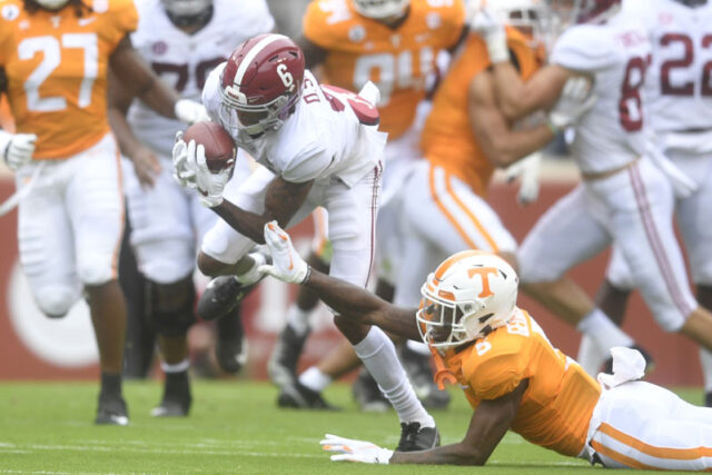 Alabama wide receiver DeVonta Smith (6) runs past Tennessee defensive back Kenneth George Jr. (5) during a game between Alabama and Tennessee at Neyland Stadium in Knoxville, Tenn. on Saturday, Oct. 24, 2020.