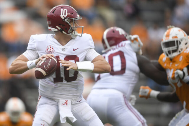 Alabama quarterback Mac Jones (10) lines up a pass during a game between Alabama and Tennessee at Neyland Stadium in Knoxville, Tenn. on Saturday, Oct. 24, 2020.