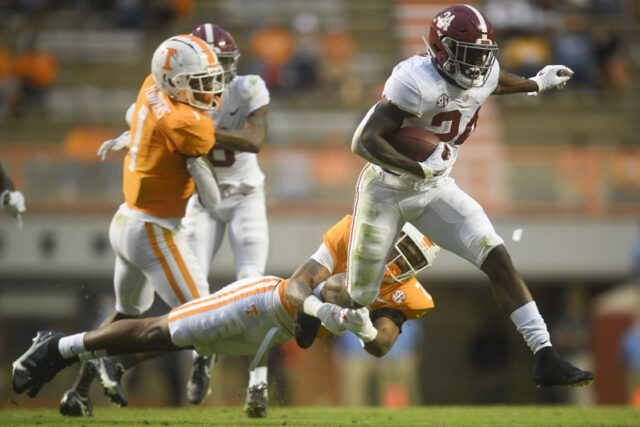 Alabama running back Trey Sanders (24) is tackled by Tennessee defensive back Tamarion McDonald (21) in the fourth quarter in the second half during a game between Alabama and Tennessee at Neyland Stadium in Knoxville, Tenn. on Saturday, Oct. 24, 2020.