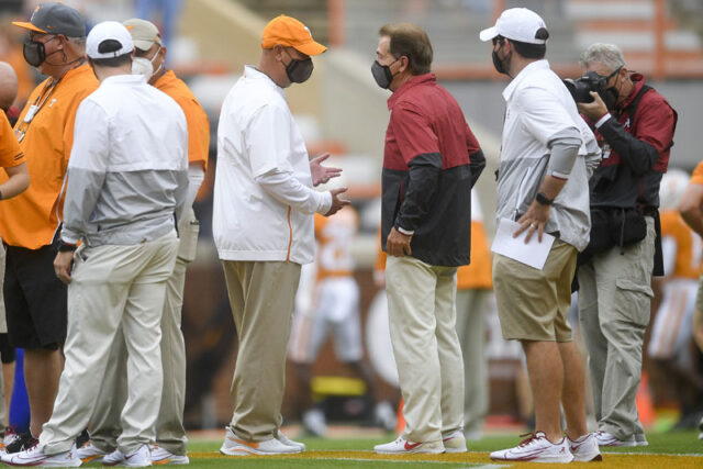 From left Tennessee Head Coach Jeremy Pruitt and Alabama Head Coach Nick Saban speak before a game between Tennessee and Alabama at Neyland Stadium in Knoxville, Tenn. Saturday, Oct. 24, 2020.