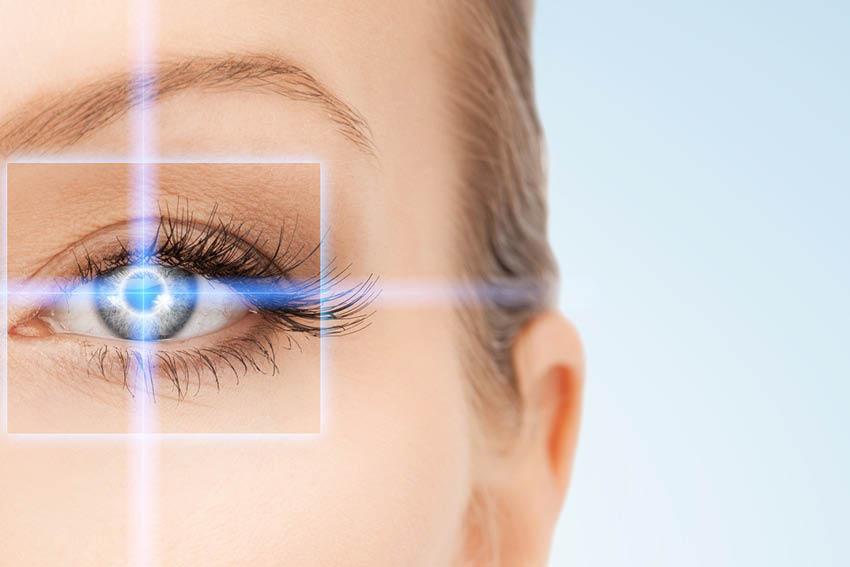 Blonde Woman's Eye Pierced by Laser Shining Light