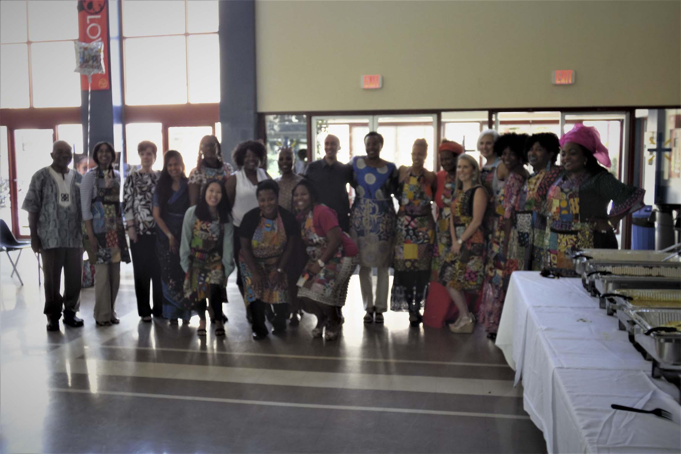 web Barankitse 2019Asike_African_Sisters_Information_Knowledge_Education_Fundraiser_2017_Goals_200Girls_2020.GROUP_Photo_Aprons_Circleweb