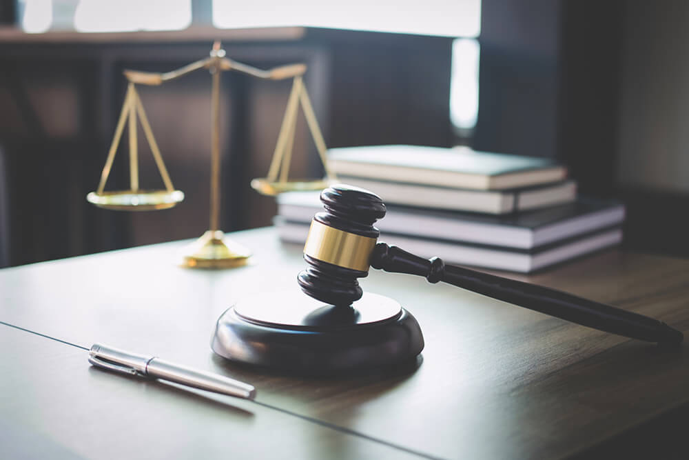 Gavel and scale representing professional licensure defense and disciplinary proceedings.