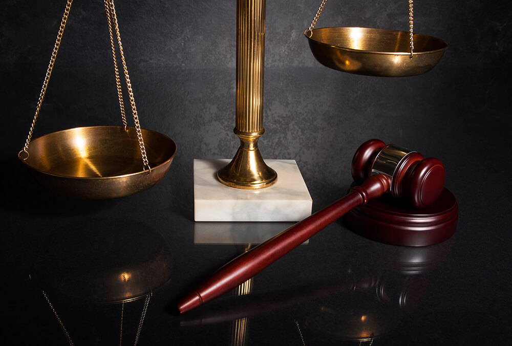 Gavel and brass scale representing white collar criminal defense