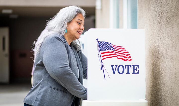 A woman at a voting booth in Albuquerque.