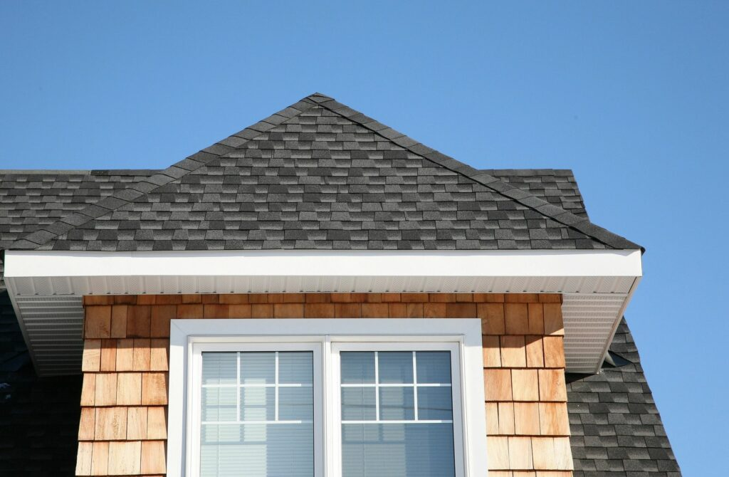 Closeup or window and roof with wooden shingles