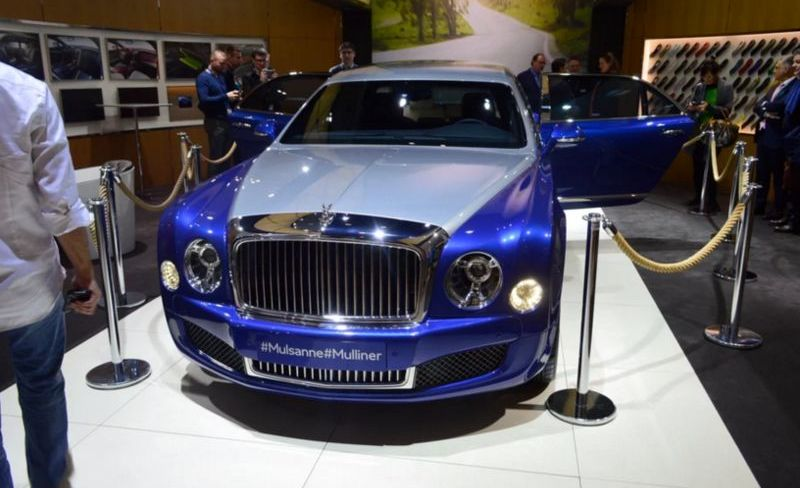 Blue limousine in car show room