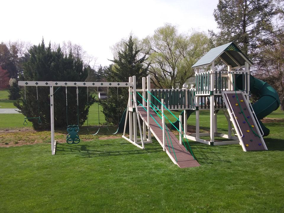 backyard playset with climbing wall