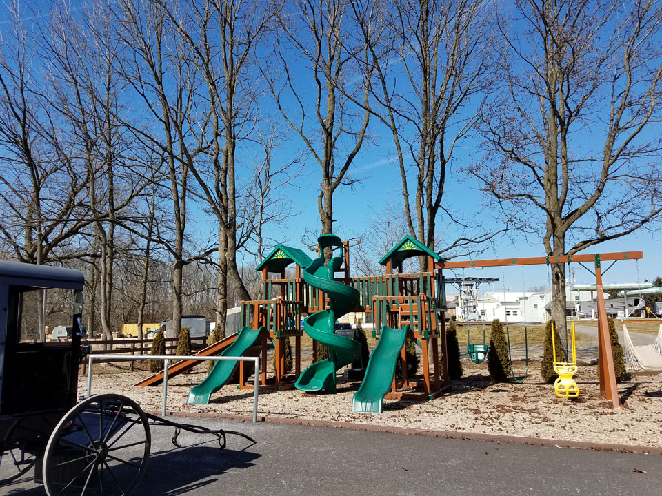 green playset with 3 slides