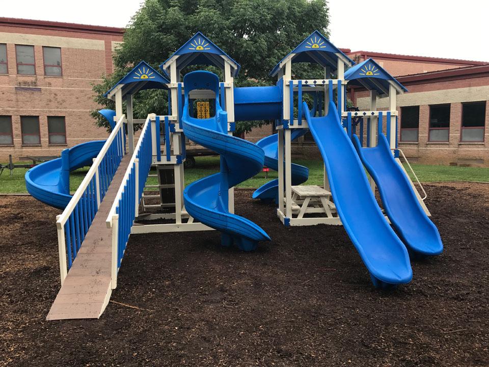 backyard playset with many slides