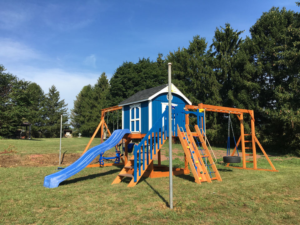 backyard playset with enclosed cabin