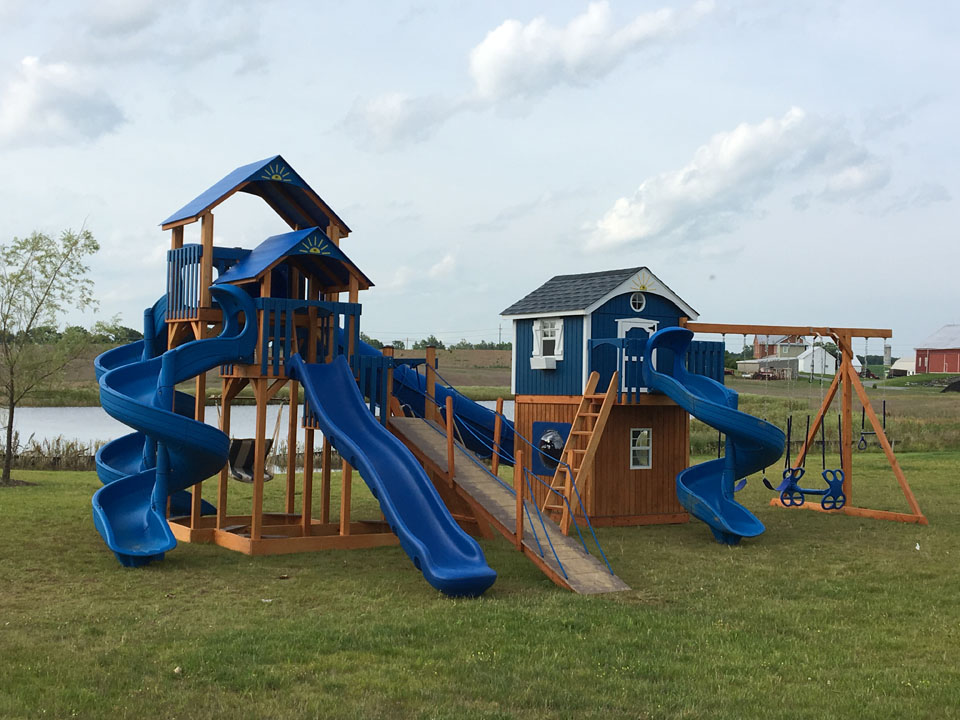 large blue playset with enclosed cabin