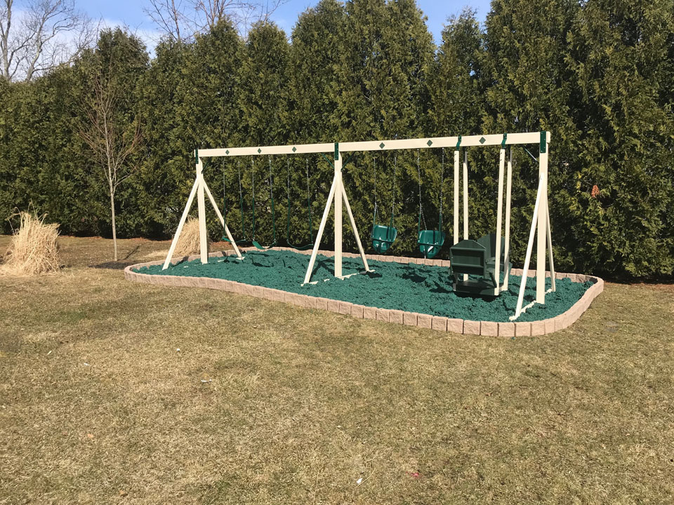 playset with green mulch outside