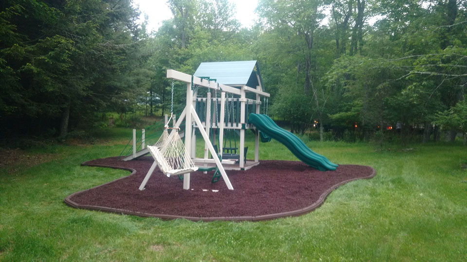 green playset with red mulch