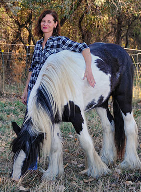 Erin Tanner Jospe and her black and white horse