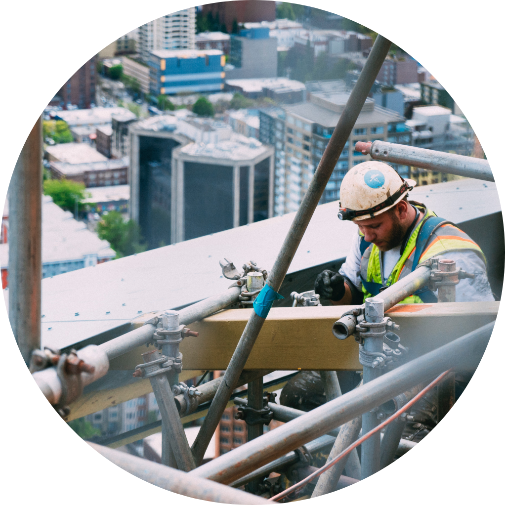 Image of construction worker on high rise scaffolding