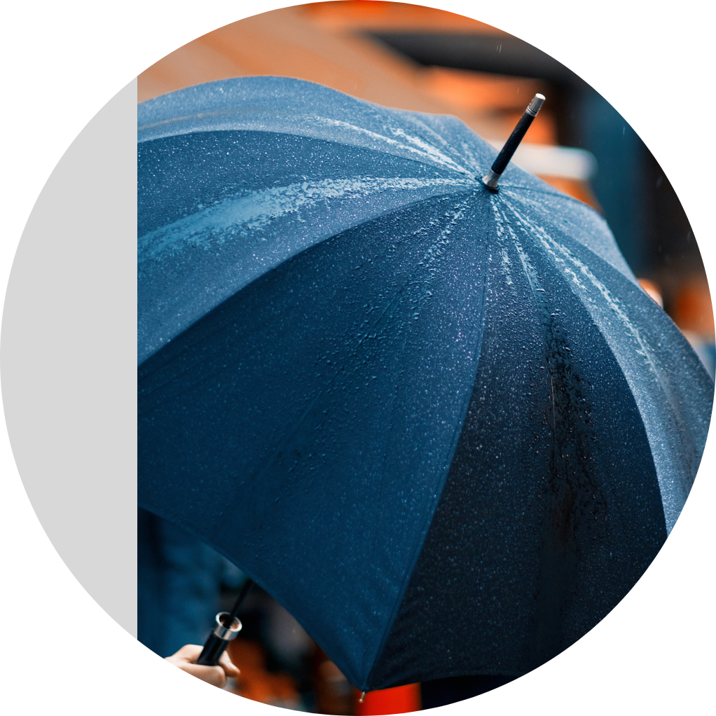 Image of a navy blue umbrella in the rain