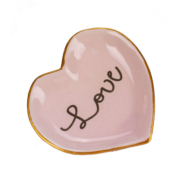 "Pink heart-shaped tray with ""Love"" written in cursive in gold with a gold rim."