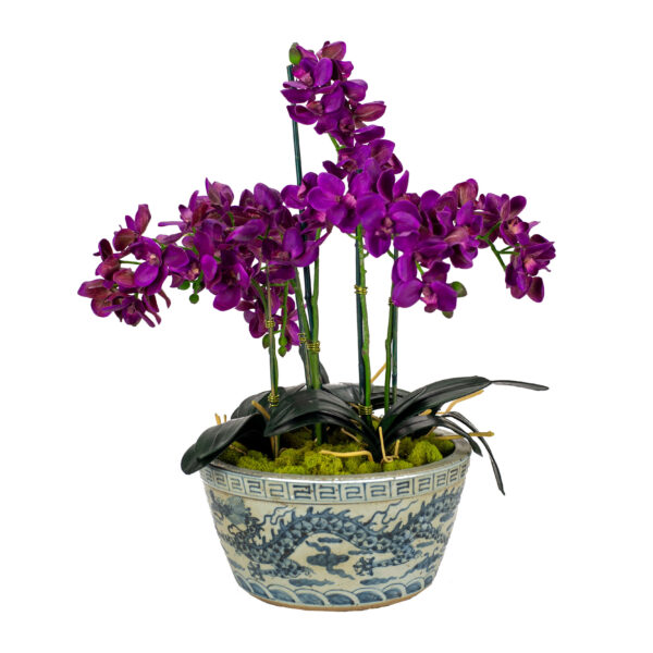 Purple Silk Orchids in a blue and white dragon vase.