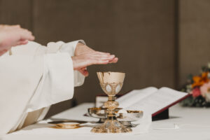 Hands of priest outstretched