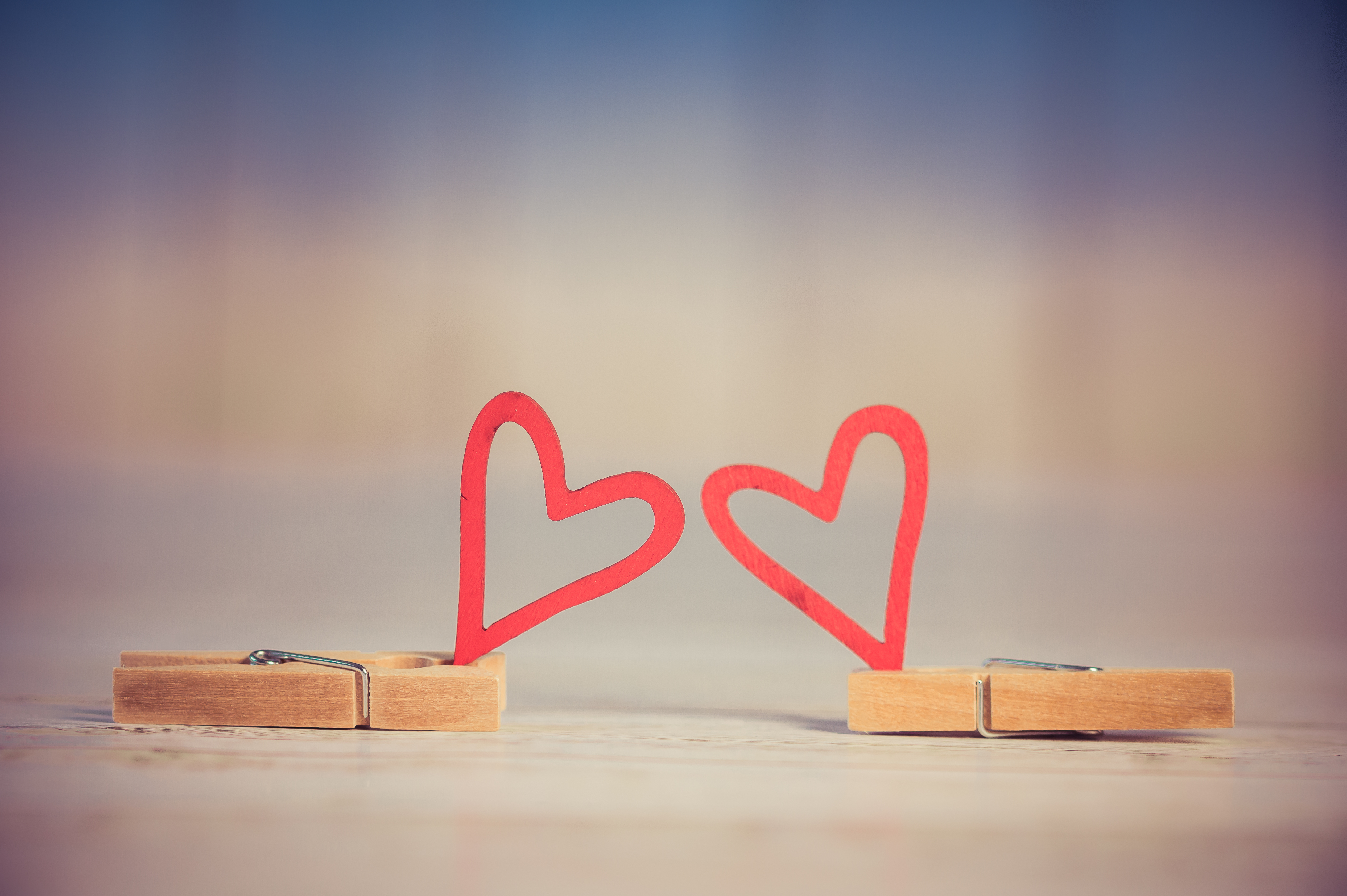 two hearts on clothes pegs