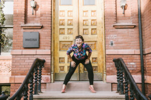 a femme on a brownstone stoop thinking of course they did
