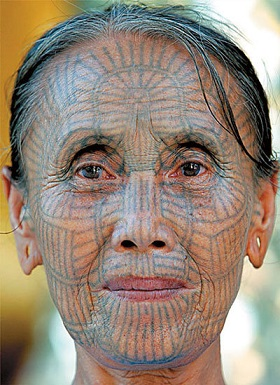 face-tattoo-cultural-lines