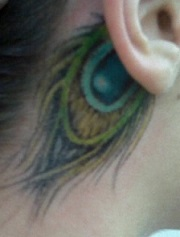 peacock-feather-tattoo-behind-ear