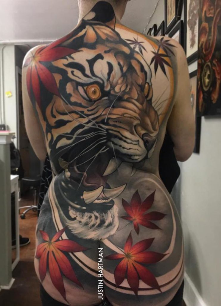 back tattoo of tiger by Justin Hartman